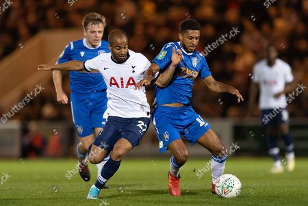 Lucas Moura of Tottenham Hotspur and Brandon Comley of Colchester United