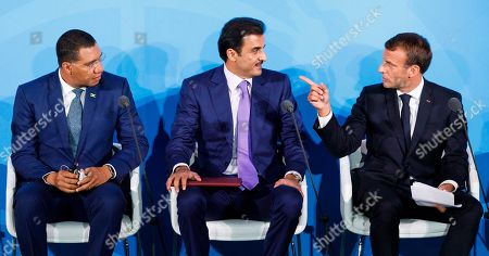 (L-R) Prime Minister of Jamaica Andrew Holness, Emir of Qatar Sheikh Tamim bin Hamad Al Thani and President of France Emmanuel Macron speak during the 2019 Climate Action Summit which is being held ahead of the General Debate of the General Assembly of the United Nations at United Nations Headquarters in New York, New York, USA, 23 September 2019. World Leaders have been invited to speak at the event, which was organized by the United Nations Secretary-General Antonio Guterres, for the purpose of proposing plans for addressing global climate change. The General Debate of the 74th session of the UN General Assembly begins on 24 September.