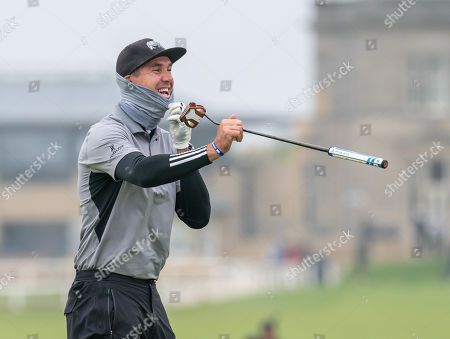 Kevin Pietersen roars with laughter on the 17th green at The Old Course, St. Andrews.