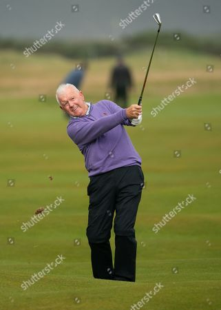 Gerry McIlroy, Rory McIlroy's Dad, plays his approach shot to the 16th green at The Old Course, St. Andrews.