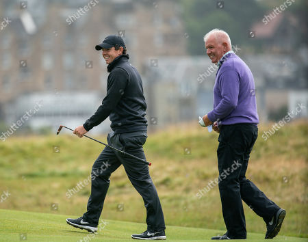 Rory McIlroy with his Dad Gerry McIlroy on the 16th green at The Old Course, St. Andrews.