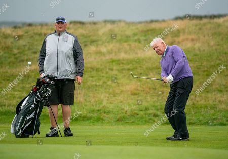 Gerry McIlroy, Rory McIlroy's Dad chips on to the 17th green at The Old Course, St. Andrews.