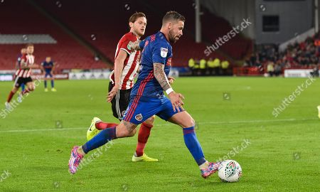 Stock Picture of Chris Maguire of Sunderland holds off Richard Stearman of Sheffield United
