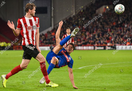 Stock Photo of Luke O'Nien of Sunderland try a spectacular overhead kick as Richard Stearman of Sheffield United looks on