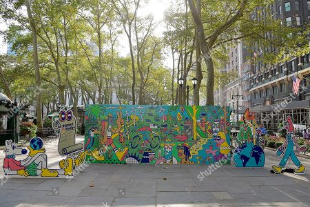 Stock Picture of View of the large-scale climate action mural pop-up in New York City's Bryant Park today to launch the #PledgeForPlanet initiative, in New York. Designed by renowned artist Steven Harrington and commissioned by Mars, Incorporated, the mural illustrates what the world could look like if we all took urgent climate action to limit global temperature rise to 1.5°C