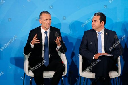 Danone Chairman and Chief Executive Officer Emmanuel Faber, left, is joined by Guatemala's President Jimmy Morales as he addresses the Climate Action Summit in the United Nations General Assembly, at U.N. headquarters