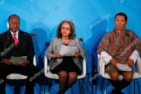 Ethiopia's President Sahle-Work Zewde, center, is joined by Vanuatu's Prime Minister Charlot Salwai, left, and Bhutan's Prime Minister Lotay Tshering, right, as she addresses the Climate Action Summit in the United Nations General Assembly, at U.N. headquarters