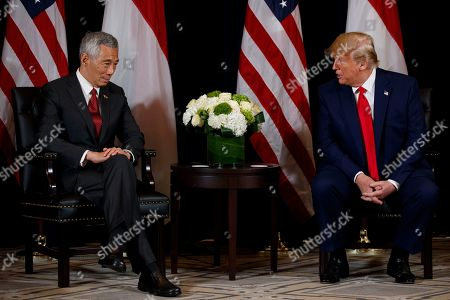 Donald Trump, Lee Hsien Loong. President Donald Trump listens to a question as he meets with Singapore Prime Minister Lee Hsien Loong at the InterContinental Barclay hotel during the United Nations General Assembly, in New York