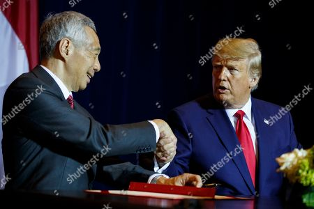 Donald Trump, Lee Hsien Loong. President Donald Trump shakes hands with Singapore Prime Minister Lee Hsien Loong at the InterContinental Barclay hotel during the United Nations General Assembly, in New York