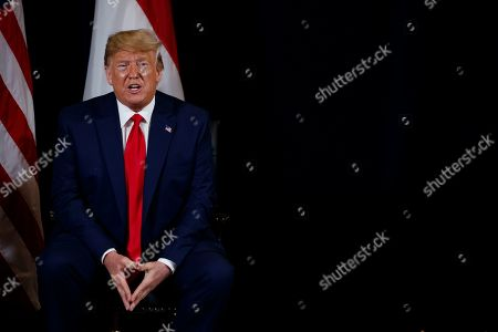 President Donald Trump speaks during a meeting with Singapore Prime Minister Lee Hsien Loong at the InterContinental Barclay hotel during the United Nations General Assembly, in New York