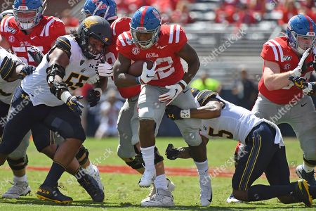 Trey Turner III, Scottie Phillips. California safety Trey Turner III (5) tackles Mississippi running back Scottie Phillips (22) during the first half of an NCAA college football game in Oxford, Miss