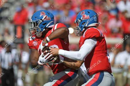 Matt Corral, Scottie Phillips. Mississippi quarterback Matt Corral (2) fakes a hand off to running back Scottie Phillips (22) during the first half of an NCAA college football game against California in Oxford, Miss