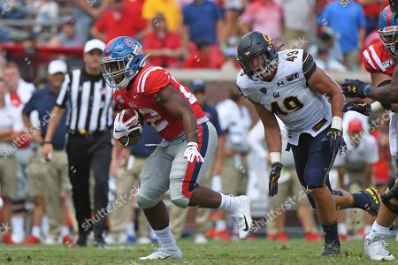 Scottie Phillips, Nick Alftin. Mississippi running back Scottie Phillips (22) carries the ball past California linebacker Nick Alftin (49) during the second half of an NCAA college football game in Oxford, Miss., . California won 28-20