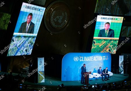 Jamaica Prime Minister Andrew Holness speaks during the Climate Action Summit 2019 at the 74th session of the United Nations General Assembly, at U.N. headquarters, . Emir of Qatar, Sheikh Tamim bin Hamad Al Thani, center and French President Emmanuel Macron at right