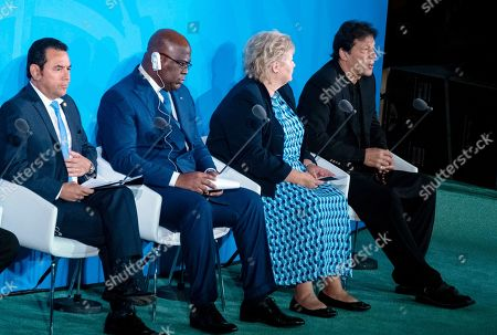 """Prime Minister of Pakistan, Imran Khan, right, speaks during the Climate Action Summit 2019 at the 74th session of the United Nations General Assembly, at U.N. headquarters, . From left are"""" Guatemalan President Jimmy Morales, Democratic Republic of Congo President Felix Tshisekedi, Norway's Prime Minister Erna Solberg, and Khan"""