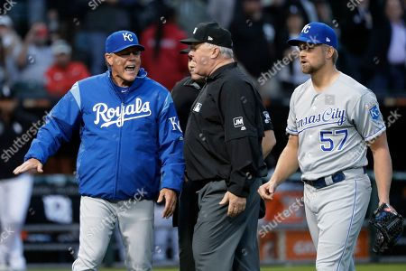 Martin Maldonado, Bill Miller. Kansas City Royals manager Ned Yost, left, appeals to umpire crew chief Bill Miller, center, after home plate umpire Mark Carlson ejected starting pitcher Glenn Sparkman (57) for hitting Chicago White Sox's Tim Anderson with a pitch during the second inning of a baseball game, in Chicago. Royals manager Ned Yost will be retiring at the end of the season, a year in which his team lost 100 games. His decision was announced by the team