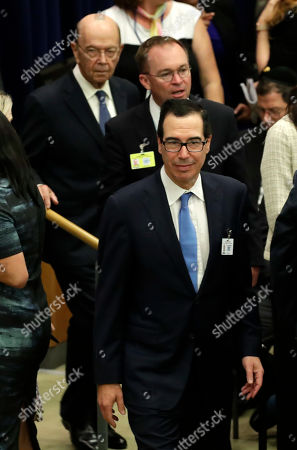 United States Secretary of the Treasury Steven Mnuchin (R), acting White House Chief of Staff Mick Mulvaney (C) and United States Secretary of Commerce Wilbur Ross (L) arrive to listen to US President Donald Trump addressing a meeting at the United Nations for a global call to protect religious freedom ahead of the General Debate of the General Assembly of the United Nations at United Nations Headquarters in New York, New York, USA, 23 September 2019. The General Debate of the 74th session of the UN General Assembly begins on 24 September.