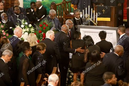 Majority Whip Jim Clyburn puts his hand on his daughter Angela Clyburn Hannibal, as the pause at the casket during for the homegoing services for his wife Emily Clyburn, in Charleston, S.C