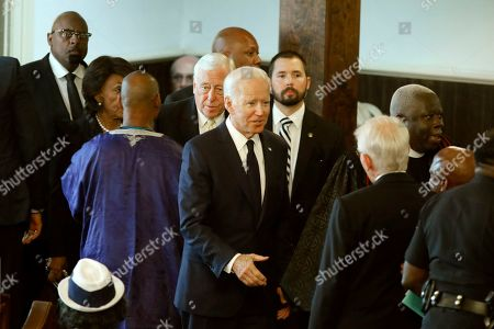 Democratic presidential candidate former Vice President Joe Biden greets the former mayor of Charleston, Joe Riley, at the homegoing services for Emily Clyburn, wife of Majority Whip Jim Clyburn, in Charleston, S.C