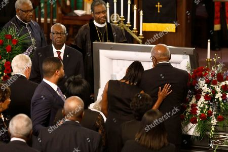 Majority Whip Jim Clyburn, right, grieves for his wife, with his daughter Angela Clyburn Hannibal, during the homegoing services for Emily Clyburn, in Charleston, S.C
