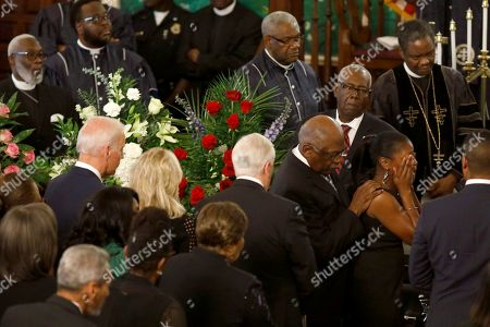 Majority Whip Jim Clyburn, second from right, and his daughter Angela Clyburn Hannibal, right, grieve during the homegoing services for his wife Emily Clyburn, in Charleston, S.C. At left is Democratic presidential candidate former Vice President Joe Biden and his wife Jill
