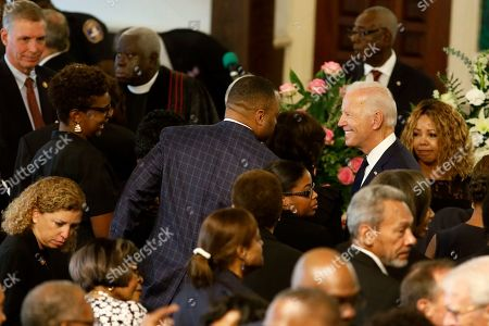 Democratic presidential candidate former Vice President Joe Biden greets several members of Congress, at the homegoing services for Emily Clyburn, wife of Majority Whip Jim Clyburn, in Charleston, S.C