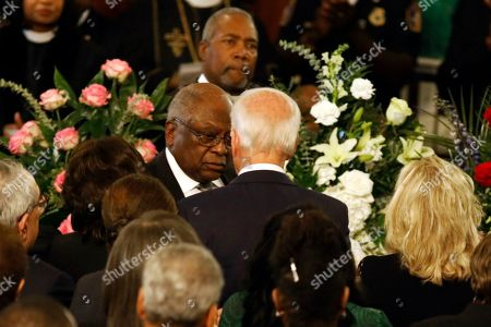 Majority Whip Jim Clyburn, left, greets Democratic presidential candidate former Vice President Joe Biden during the homegoing services for his wife Emily Clyburn, in Charleston, S.C