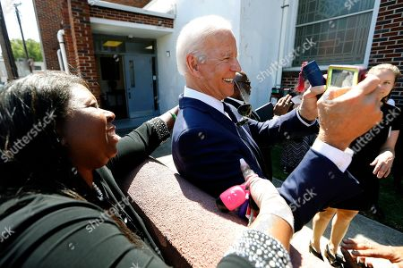 Democratic presidential candidate former Vice President Joe Biden takes selfies with supporters after the funeral for Majority Whip Jim Clyburn's wife, Emily Clyburn, at Morris Brown AME Church, in Charleston, S.C