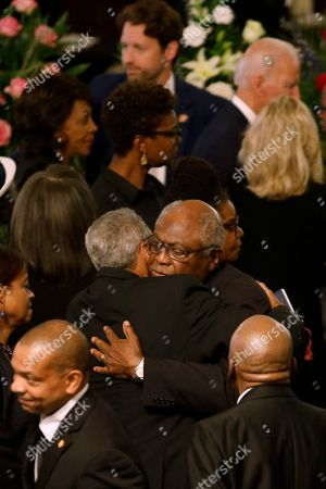 Majority Whip Jim Clyburn receives a hug while surrounded by several members of Congress during the homegoing services for his wife Emily Clyburn, in Charleston, S.C
