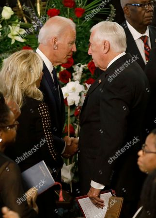 Democratic presidential candidate former Vice President Joe Biden, at left, greets House Majority Leader Steny Hoyer after the homegoing service for Majority Whip Jim Clyburn's wife, Emily Clyburn, in Charleston, S.C