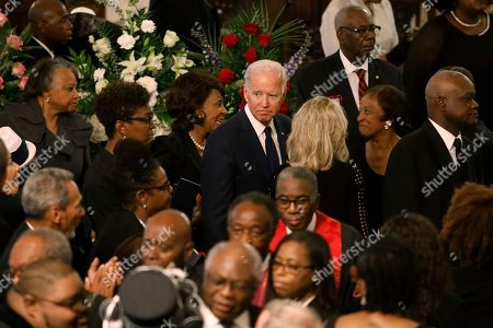 Democratic presidential candidate former Vice President Joe Biden looks out to several members of Congress, during the homegoing services for Majority Whip Jim Clyburn's wife Emily Clyburn, in Charleston, S.C
