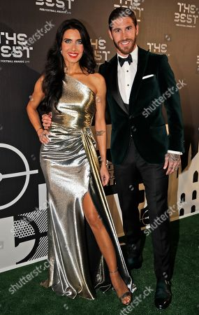 Real Madrid's Sergio Ramos arrives with his partner Pilar Rubio to attend the Best FIFA soccer awards, in Milan's La Scala theater, northern Italy, . Netherlands defender Virgil van Dijk is up against five-time winners Cristiano Ronaldo and Lionel Messi for the FIFA best player award and United States forward Megan Rapinoe is the favorite for the women's award