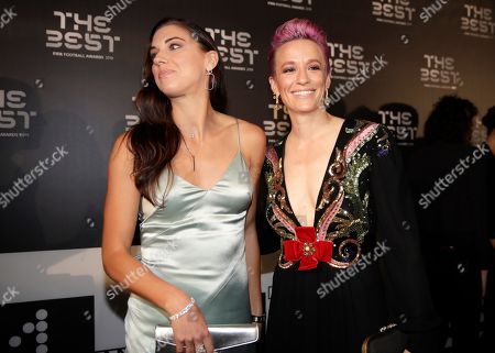 United States forward Megan Rapinoe, right, arrives with Alex Morgan to attend the Best FIFA soccer awards, in Milan's La Scala theater, northern Italy, . Netherlands defender Virgil van Dijk is up against five-time winners Cristiano Ronaldo and Lionel Messi for the FIFA best player award and Rapinoe is the favorite for the women's award