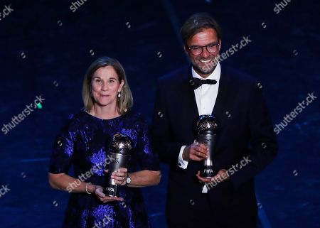 United States women's World Cup winning coach Jill Ellis poses with Liverpool manager Juergen Klopp after they received the Best FIFA coach award during the Best FIFA soccer awards ceremony, in Milan's La Scala theater, northern Italy