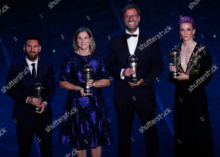 Argentinian Barcelona player Lionel Messi, United States women's World Cup winning coach Jill Ellis, Liverpool manager Juergen Klopp and United States forward Megan Rapinoe pose after they received the Best FIFA coach award, best FIFA men's, Women's player award during the Best FIFA soccer awards ceremony, in Milan's La Scala theater, northern Italy