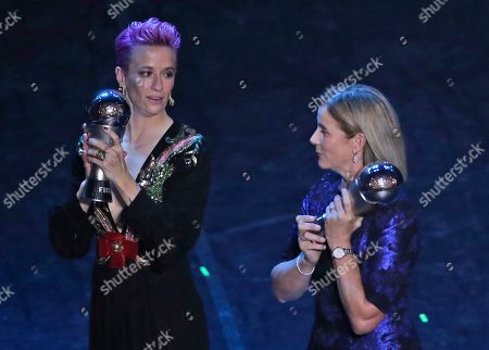 United States women's World Cup winning coach Jill Ellis and United States forward Megan Rapinoe pose after they received the Best FIFA coach award, best FIFA men's, Women's player award during the Best FIFA soccer awards ceremony, in Milan's La Scala theater, northern Italy