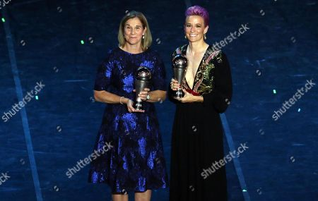 US national team coach Jill Ellis (L) and US forward Megan Rapinoe pose with their Best FIFA Women's Coach and  The Best FIFA Women's Player awards respectively during the Best FIFA Football Awards 2019 in Milan, Italy, 23 September 2019.