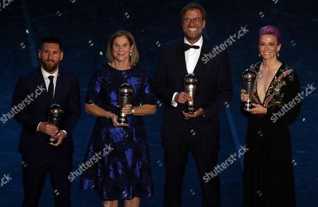 (L-R) Lionel Messi, Jill Ellis, Juergen Klopp and Megan Rapinoe pose with their awards during The Best FIFA Football Awards 2019 in Milan, Italy, 23 September 2019.