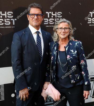 Picture made available 24 September 2019 of former AC Milan and England coach Fabio Capello (L) and his wife Laura Ghisi arriving for the Best FIFA Football Awards 2019 in Milan, Italy, 23 September 2019.