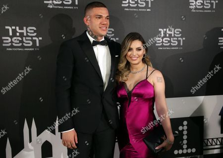 Picture made available 24 September 2019 of Brazil and Manchester City goalkeeper Ederson  (L) and his wife Lais Moraes arriving for the Best FIFA Football Awards 2019 in Milan, Italy, 23 September 2019.