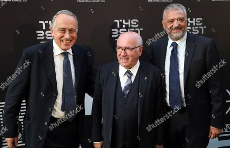 Picture made available 24 September 2019 of of (L-R) third vice president of UEFA Giancarlo Abete, former president of the Italian soccer federation Carlo Tavecchio and former Italian international Alessandro Altobelli as they arrive for the Best FIFA Football Awards 2019 in Milan, Italy, 23 September 2019.