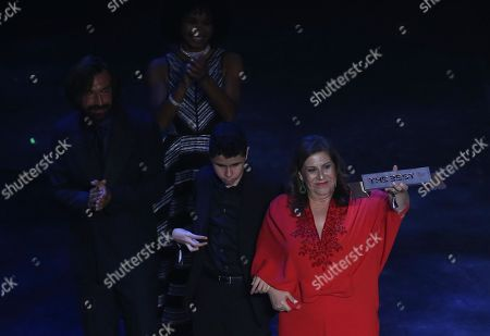 Sylvia Grecco and her son Nikollas who is blind receive the FIFA Fan Award from former Italian international Andrea Pirlo (L) during the Best FIFA Football Awards 2019 in Milan, Italy, 23 September 2019. They are supporters of Brazilian team Sociedade Esportiva Palmeiras