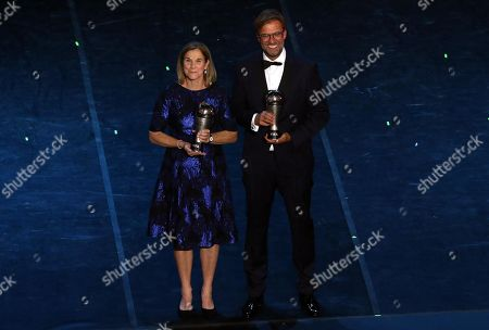 US national team coach Jill Ellis (L) and Liverpool manager Juergen Klopp pose with their Best FIFA Women's Coach and Best FIFA Men's coach awards respectively during the Best FIFA Football Awards 2019 in Milan, Italy, 23 September 2019.