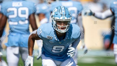 Stock Image of North Carolina's Cam'Ron Kelly warms up prior to the start of an NCAA college football game in Chapel Hill, N.C