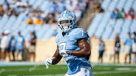 North Carolina's Jonathan Smith warms up prior to the start of an NCAA college football game in Chapel Hill, N.C
