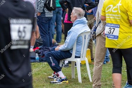 Lord Jeffrey Archer having to sit during the race around the colleges of Cambridge