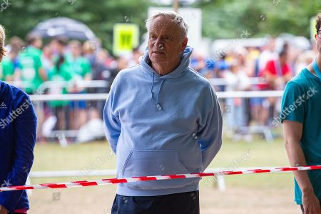 Lord Jeffrey Archer waiting for his wife Dame Mary to run past as she took part in the race in Cambridge Lord Archer had tendonitis and was struggling to walk