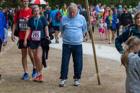 Lord Jeffrey Archer struggling to walk at the race in Cambridge in which his wife took part.Lord Archer had tendonitis and was struggling to stand and walk.