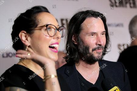 Stock Photo of Karina Miller and Keanu Reeves