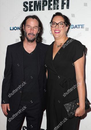 Stock Image of Keanu Reeves and Karina Miller